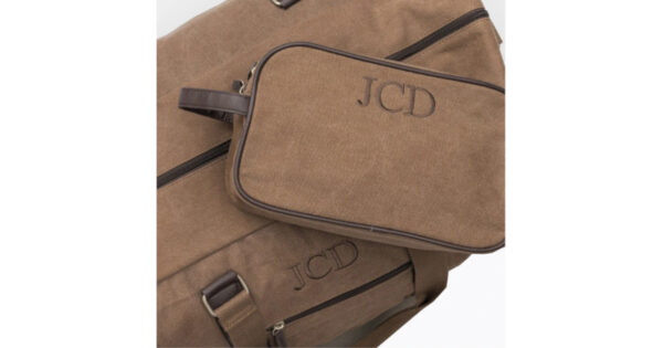 Brown canvas duffle and dopple bag embroidered with JCD monogram