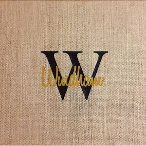 Burlap Placemat with last name: Windham in yellow layered on top of W initial in black